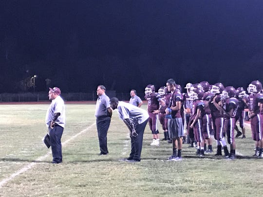 The Tularosa High School coaching staff react to a play at Friday night's game versus the Hatch Valley Bears.