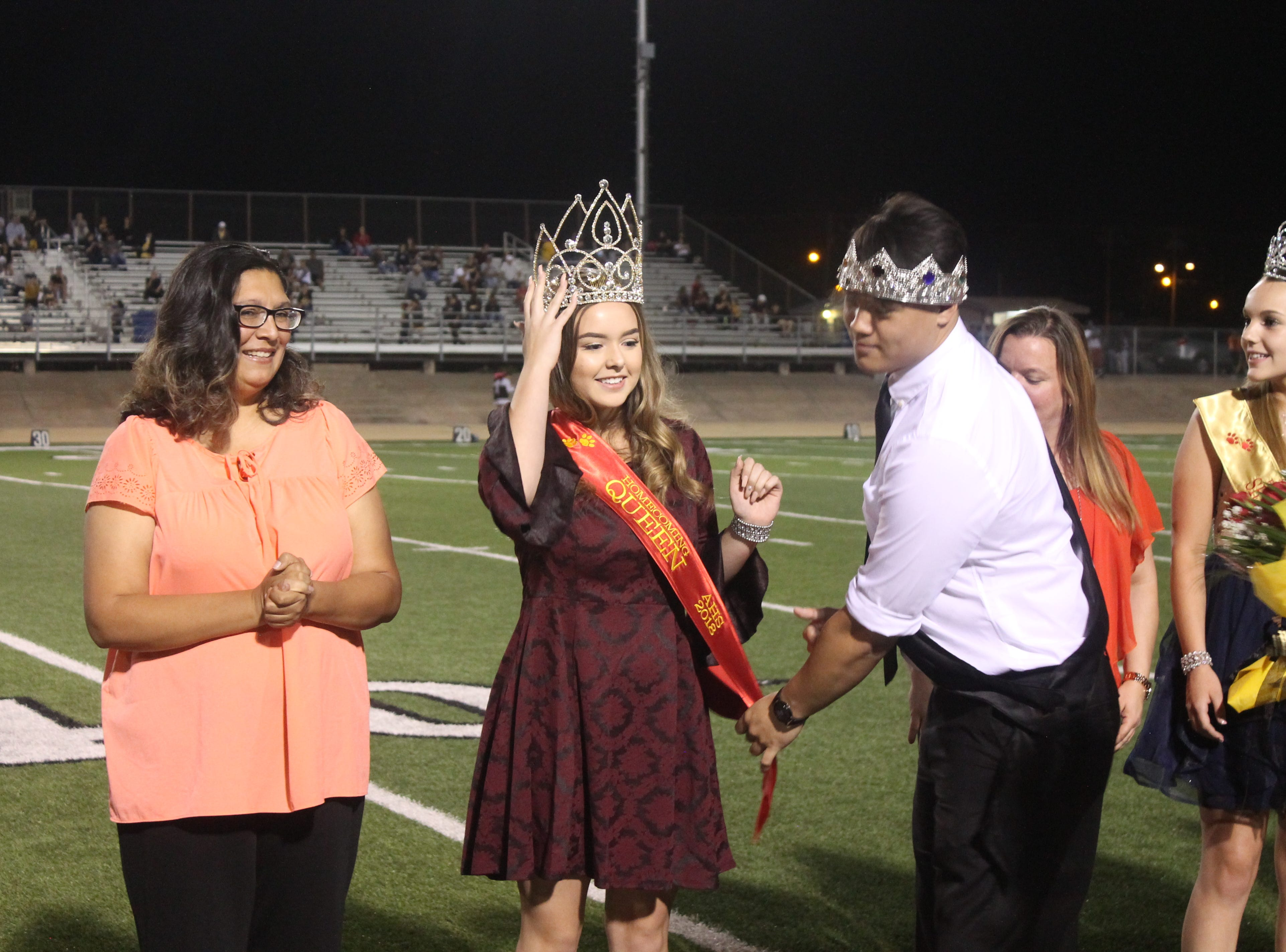Alamogordo High School's 2018 Homecoming Queen Deja-Rae Kosier receives her sash from 2017 king Casey Myers.