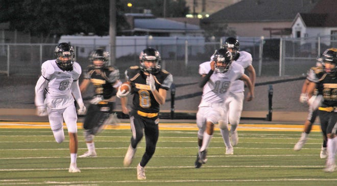 Alamogordo Tiger wide receiver Will Gil charges down the field in the homecoming game against Chaparral.