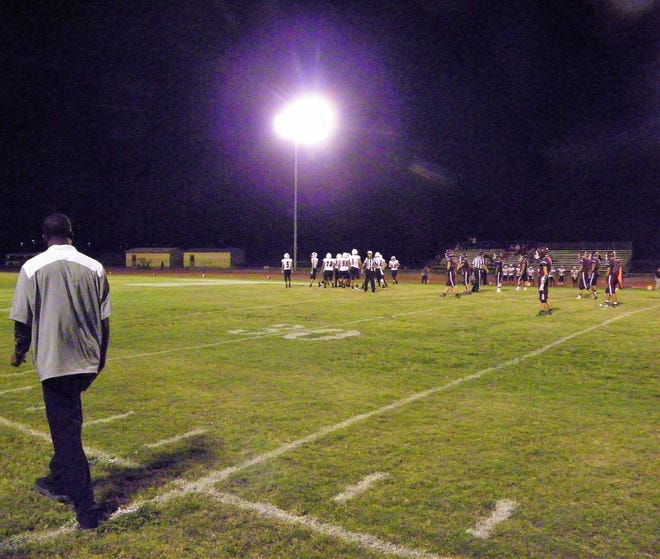 Coach Emory Coleman watches the Tularosa Wildcats prepare to run a play.