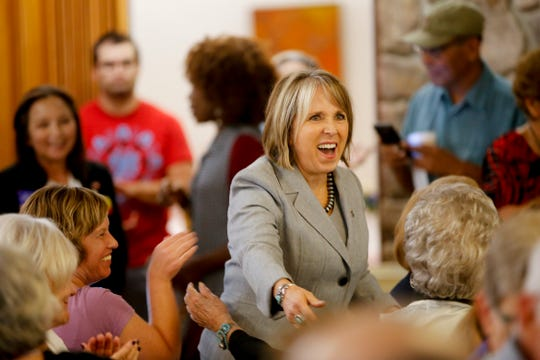 New Mexico governor U.S. Rep. Michelle Lujan Grisham meets with local Democratic Party members. Friday, Oct. 5, 2018 during a campaign stop at Chef Bernie's in Farmington.