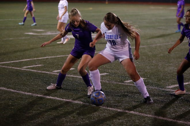 Kirtland Central's Abby Chapman and Bloomfield's Sydney Duggar battle for possession of the ball during Thursday's District 1-4A match at KCHS. Visit daily-times.com to see the latest sports results, photo galleries and video highlights.