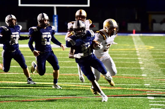 One of Farmington's top performers Friday night was senior running back Kendall Williams, who scored twice against North Farmington.