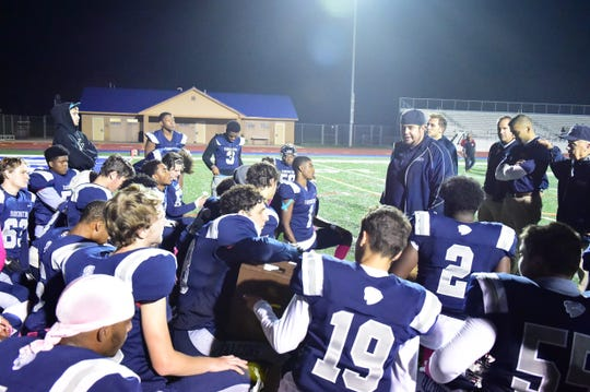 Job well done boys, says Farmington head coach Kory Cioroch to Falcons' players after 27-7 win over North Farmington.