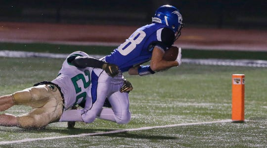 Oshkosh West's A.J. Ambroso falls into the end zone for a touchdown during Friday's game against Oshkosh North.  Joe Sienkiewicz/USA Today NETWORK-Wisconsin