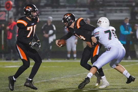 Ripon quarterback Max Huseboe (4)  gets pulled down by Christopher Kurczek (78) of Berlin. The Ripon Tigers hosted the Berlin Indians in an East Central Conference matchup Friday evening, October 5, 2018 at Ingalls Field.