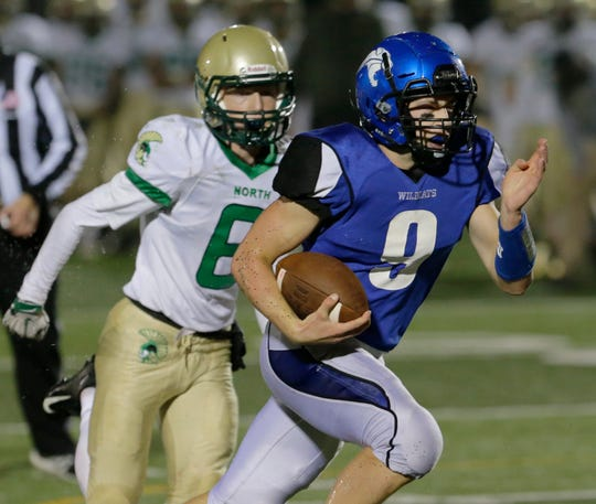 Oshkosh West's Blake Framke takes off for a touchdown against Oshkosh North.