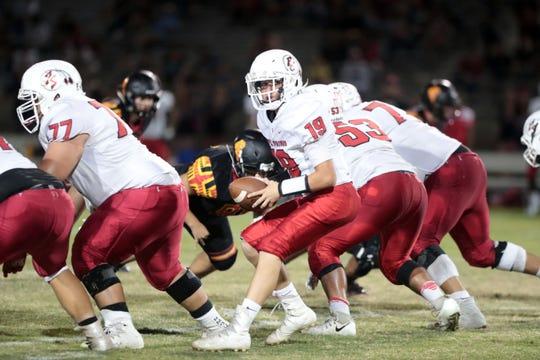 Freshman quarterback Christian Kretz runs a play for Palm Springs against Palm Desert on Oct. 5.