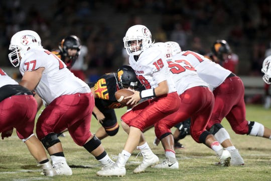Freshman quarterback Christian Kretz runs a play for Palm Springs against Palm Desert on Oct. 5.