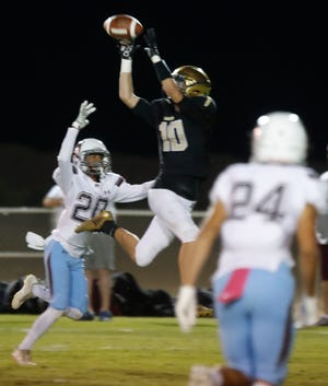 Xavier Prep's Logan Peszko makes a catch for gain against Rancho Mirage on October 5, 2018.