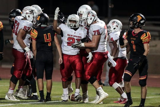 Palm Springs' Kelton Johnson and team celebrates his touchdown against Palm Desert on Friday, October 5, 2018 in Palm Desert.