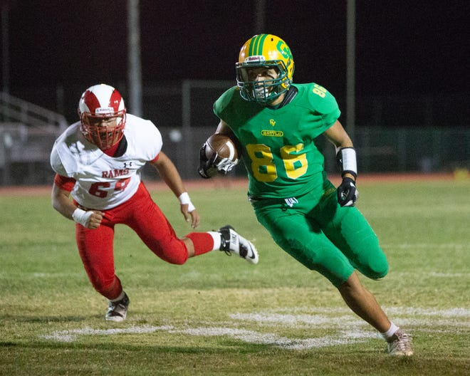 Andres Medina catches a short pass from Donny Fitzgerald and gets a touchdown.  The Coachella Valley varsity football team won Friday's home conference game against Desert Mirage (Thermal, CA) by a score of 63-14.