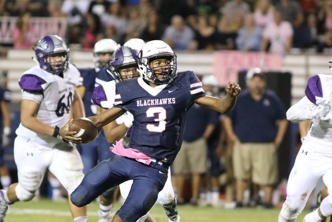 Christian Egson of La Quinta breaks loose on a run, part of his 154 rushing yards in La Quinta's 27-10 win over Shadow Hills