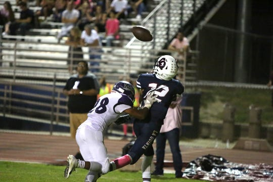Nathaniel Perez catches a touchdown pass in the corner of the end zone for La Quinta in a 27-10 win over Shadow Hills.