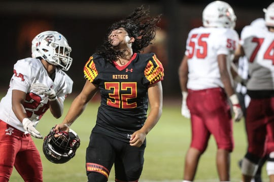 Palm Desert''s Angel Barrientos wipes his hair during play with Palm Springs on Friday, October 5, 2018 in Palm Desert.