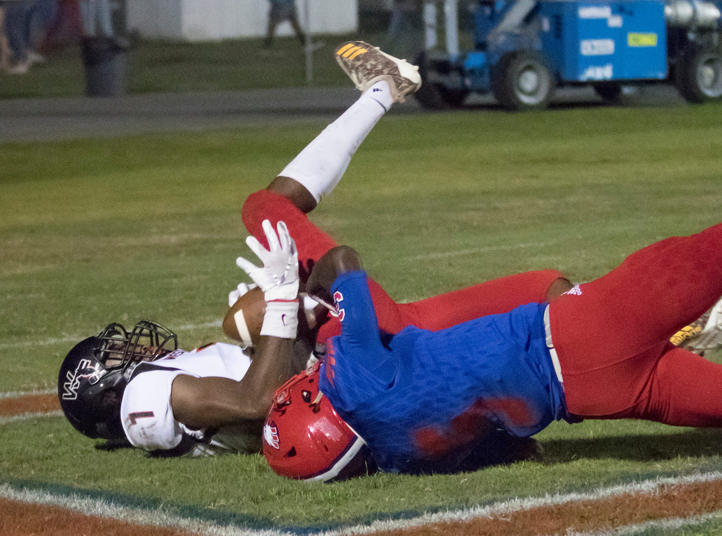 Keion Burrell (7) holds onto the pass for a touchdown during the West Florida vs Pine Forest football game at Pine Forest High School in Pensacola on Friday, October 5, 2018.  The Eagles lead was 14-12 after the Jaguars' 2 point attempt failed.