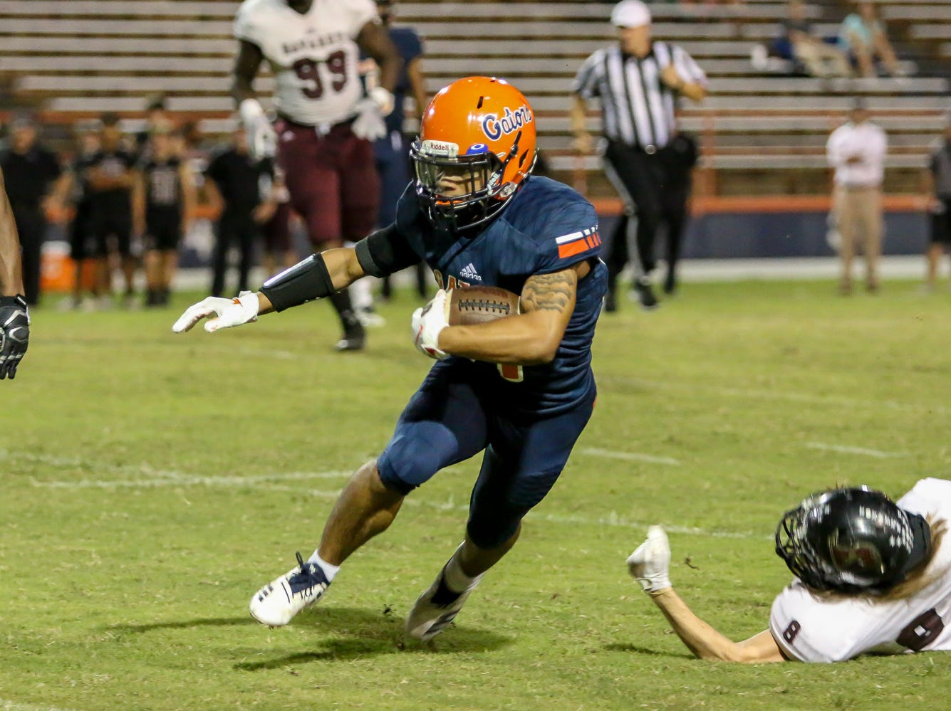Escambia's Jaylen Blackmon (14) cuts to the outside against the Navarre defense in the homecoming game at Escambia High School on Friday, October 5, 2018.