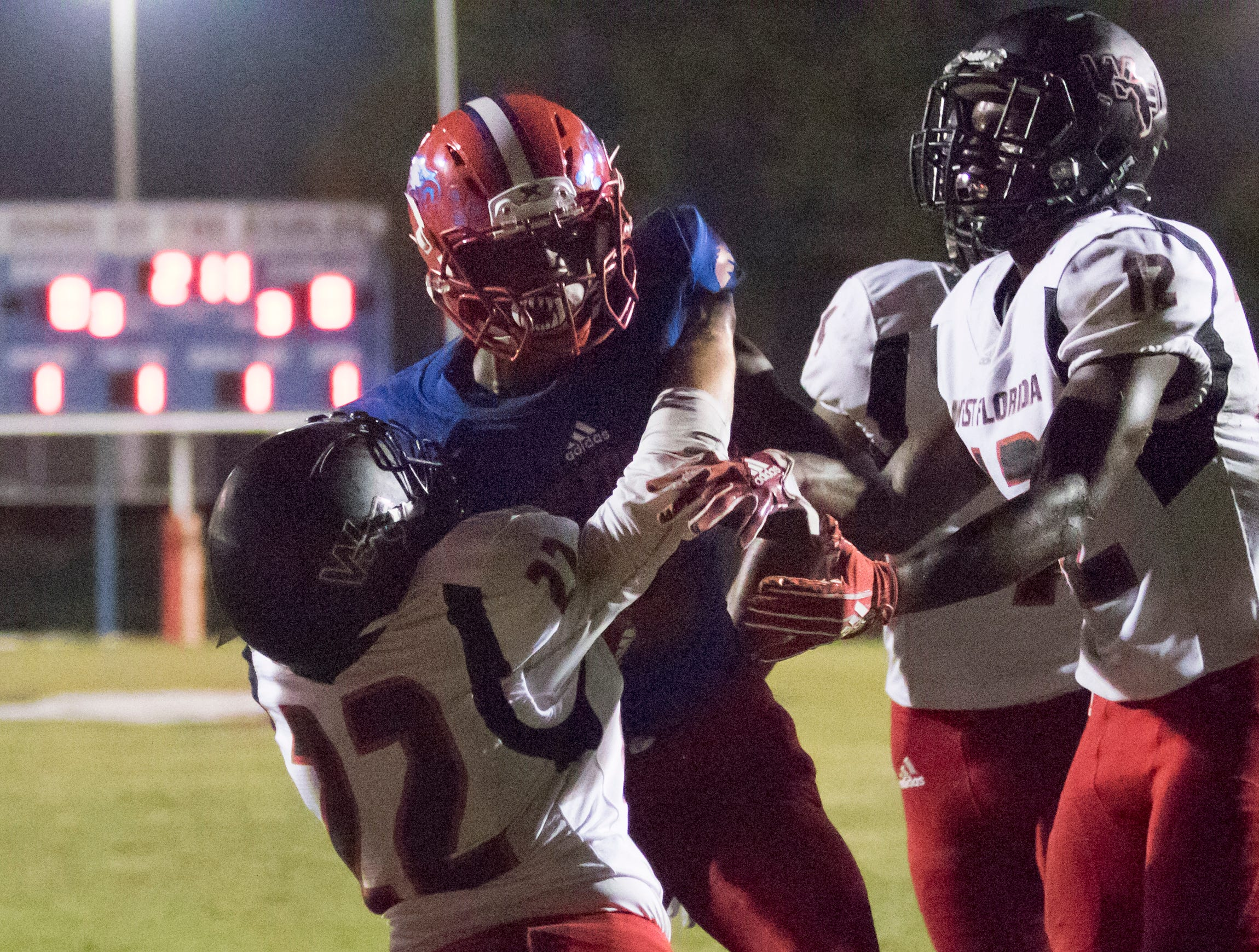 Anwar Lewis (25) takes it in for a touchdown and a 7-0 lead during the West Florida vs Pine Forest football game at Pine Forest High School in Pensacola on Friday, October 5, 2018.