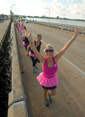 Breast cancer survivors, their loved ones and the community participate in the ninth annual Bras Across the Bridge Saturday, October 6, 2018. The crowd made its way across the Bob Sikes Bridge from the Grand Marlin Restaunt and Oyster Bar with bras strung together for awareness and support in the fight against breast cancer. Funds raised benefit the Baptist Health Care Foundations Mammorgam Fund.