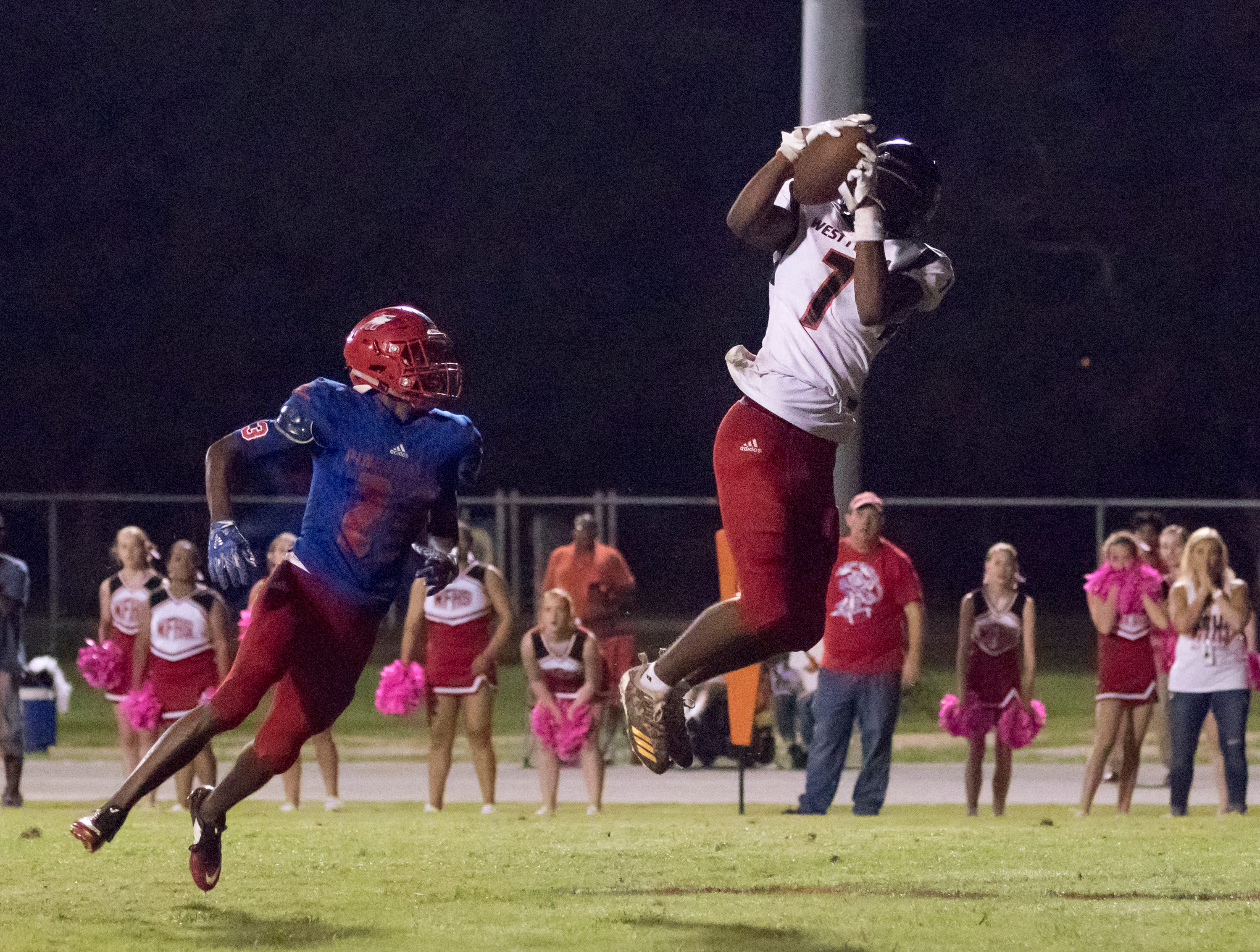 Keion Burrell (7) makes a leaping catch for a touchdown and a 25-24 lead during the West Florida vs Pine Forest football game at Pine Forest High School in Pensacola on Friday, October 5, 2018.