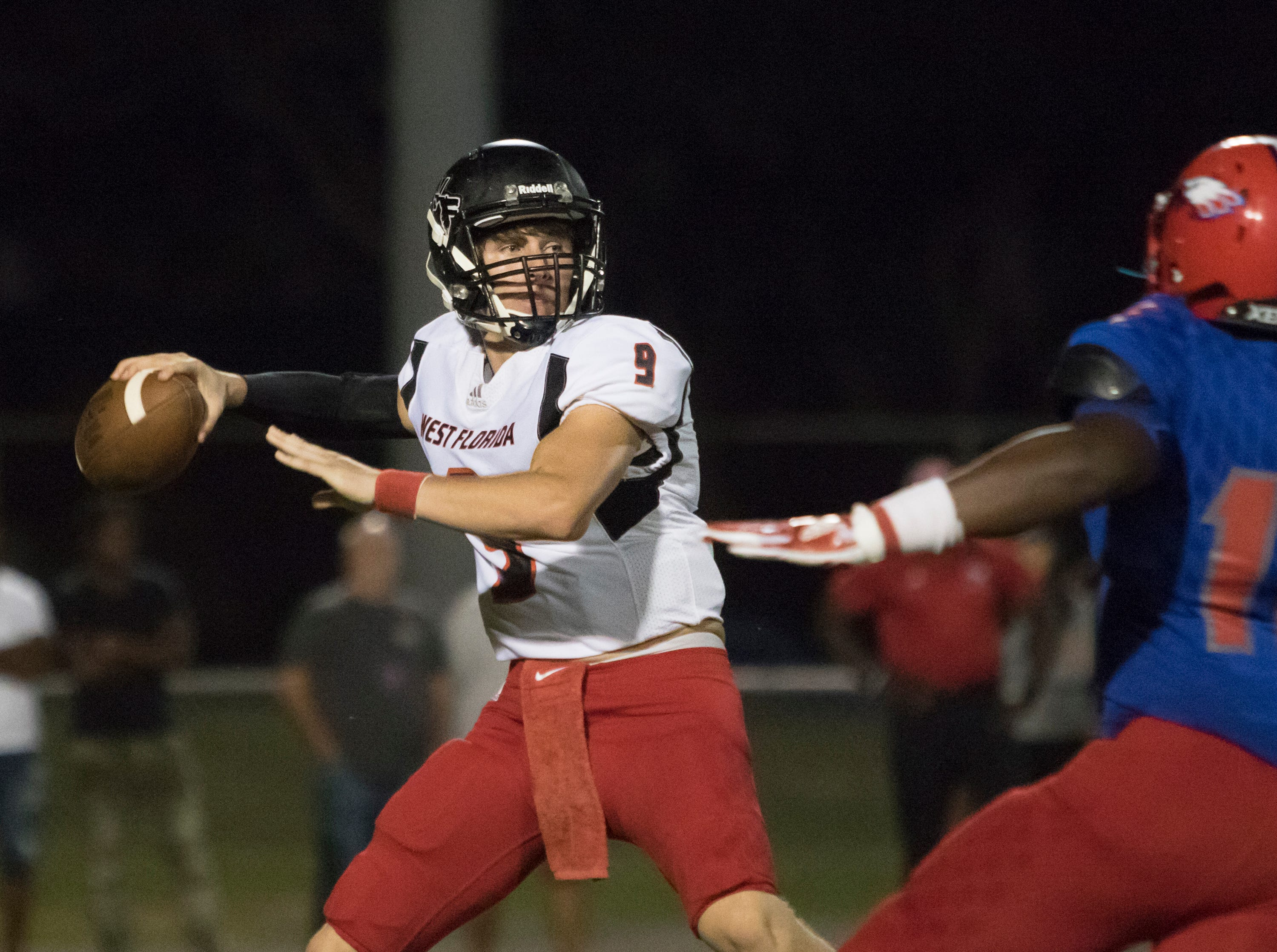 Quarterback Trevor Jordan (9) gets set to pass during the West Florida vs Pine Forest football game at Pine Forest High School in Pensacola on Friday, October 5, 2018.