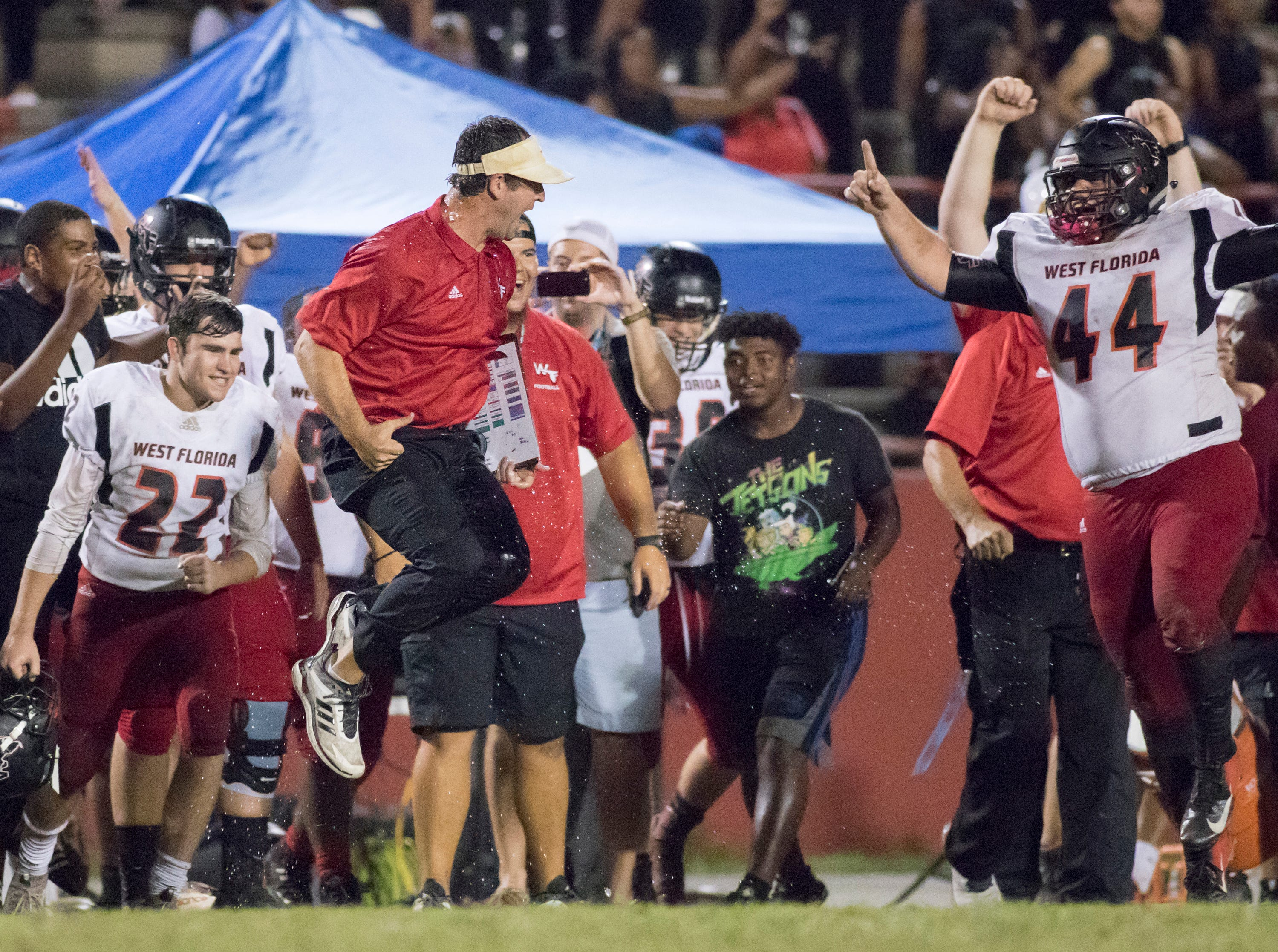 Jaguars head coach Rhett Summerford reacts after getting a Gatorade bath after a thrilling 27-24 win during the West Florida vs Pine Forest football game at Pine Forest High School in Pensacola on Friday, October 5, 2018.