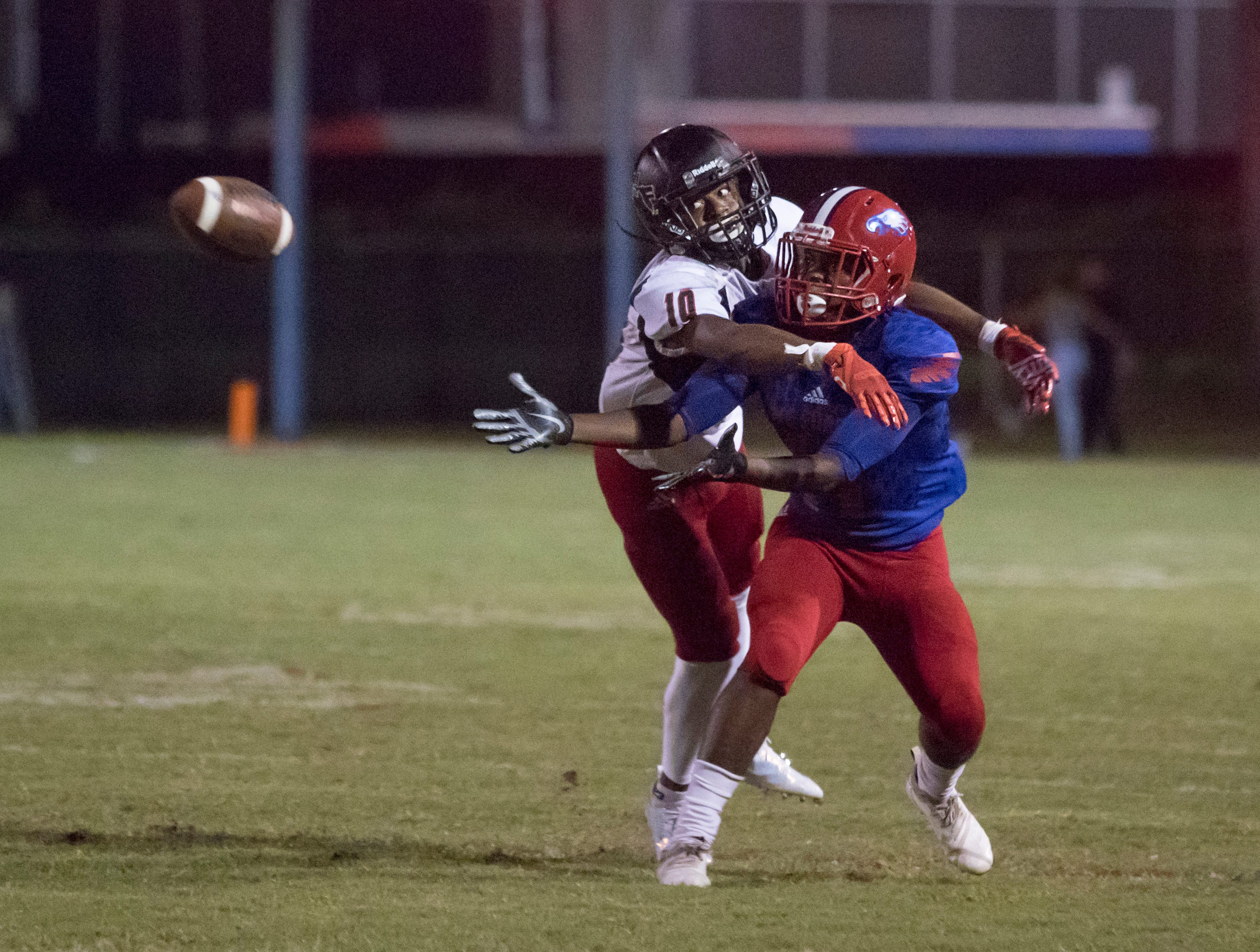 Donte Thompson (10) breaks up the pass during the West Florida vs Pine Forest football game at Pine Forest High School in Pensacola on Friday, October 5, 2018.