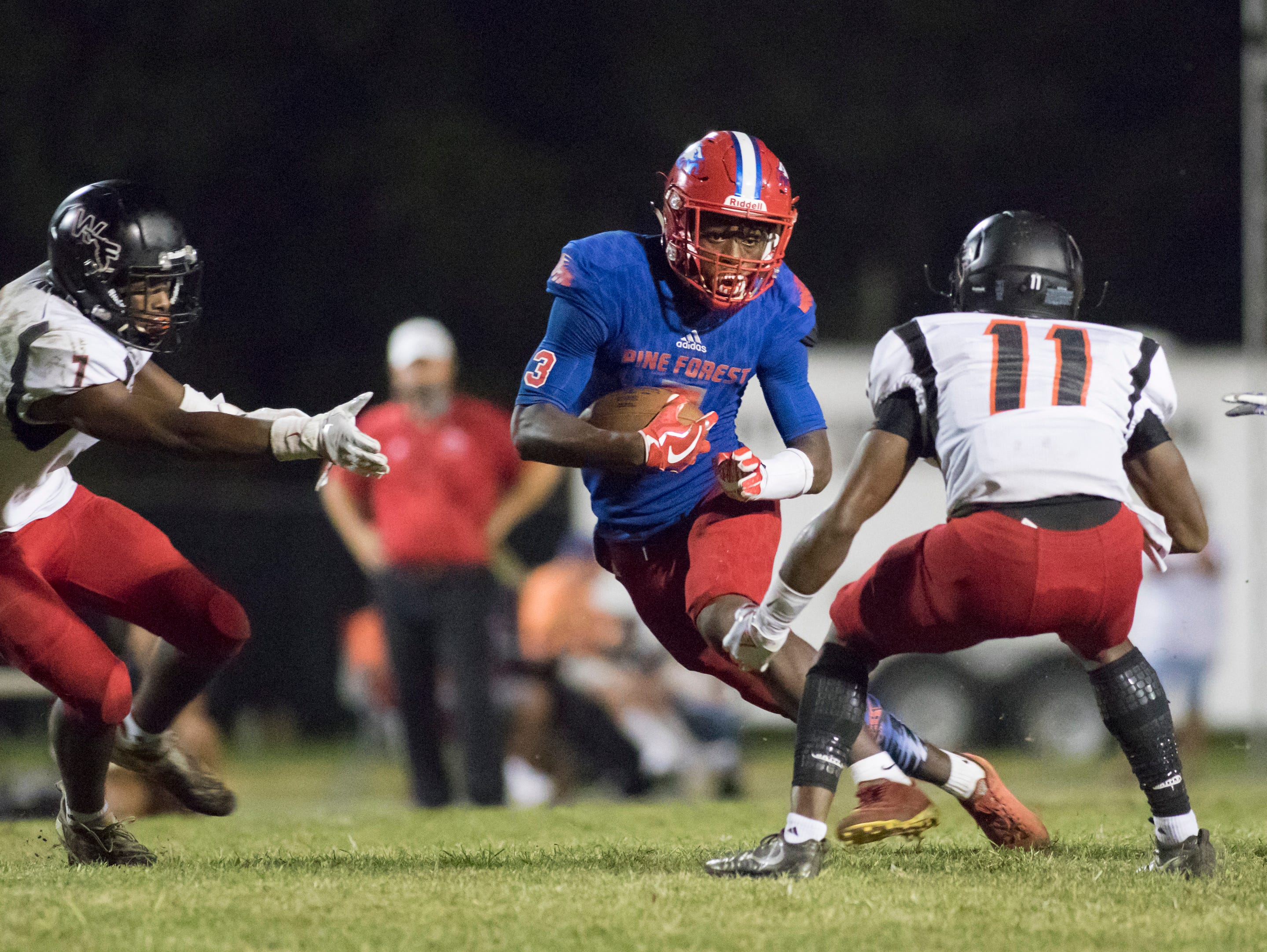 Tehrenzo Turner (7) carries the ball during the West Florida vs Pine Forest football game at Pine Forest High School in Pensacola on Friday, October 5, 2018.