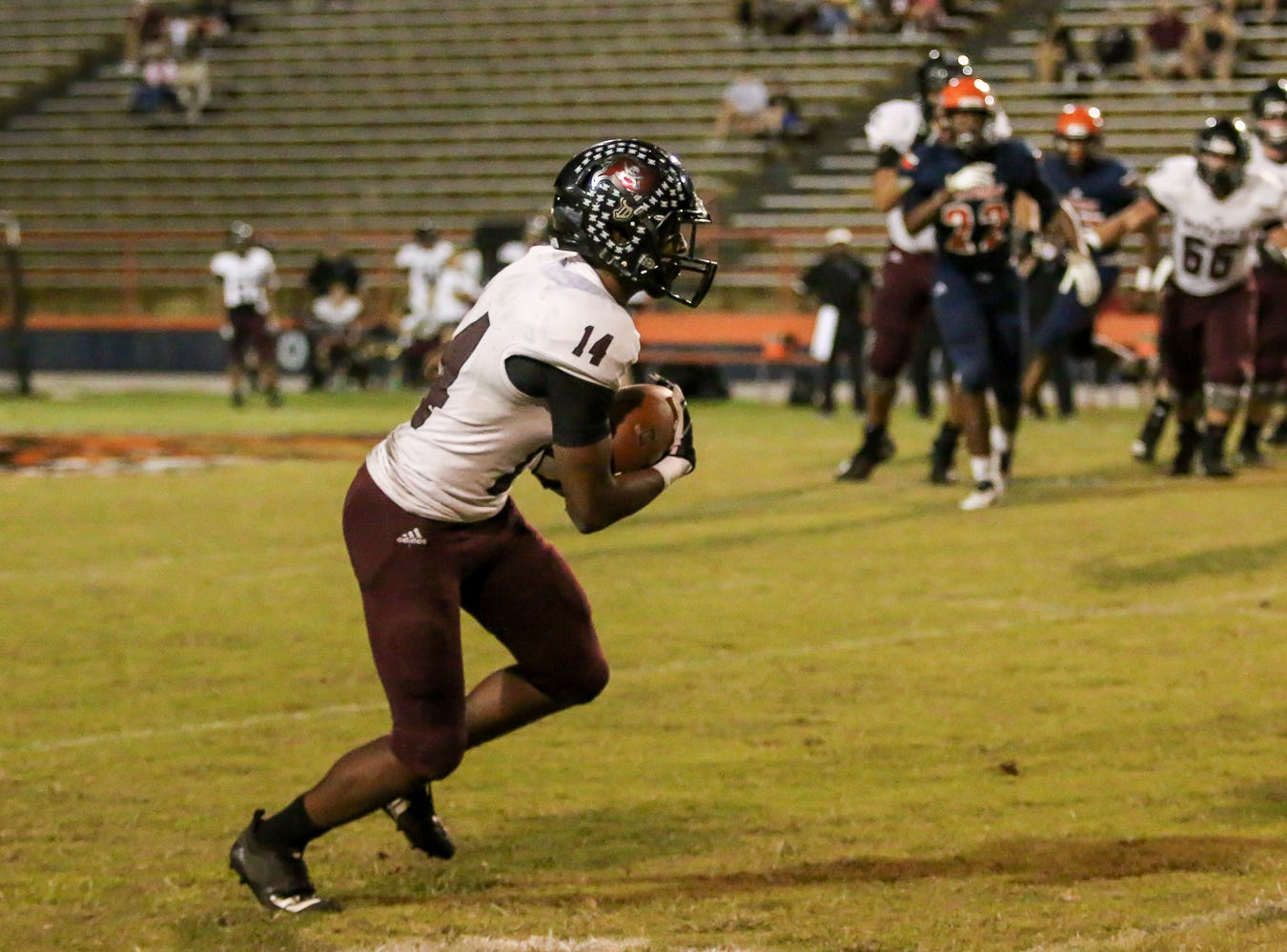 Navarre wide receiver Quinn Caballero (14) catches a pass from quarterback Marlon Courtney III and heads up the field against the Gators at Escambia High School on Friday, October 5, 2018.