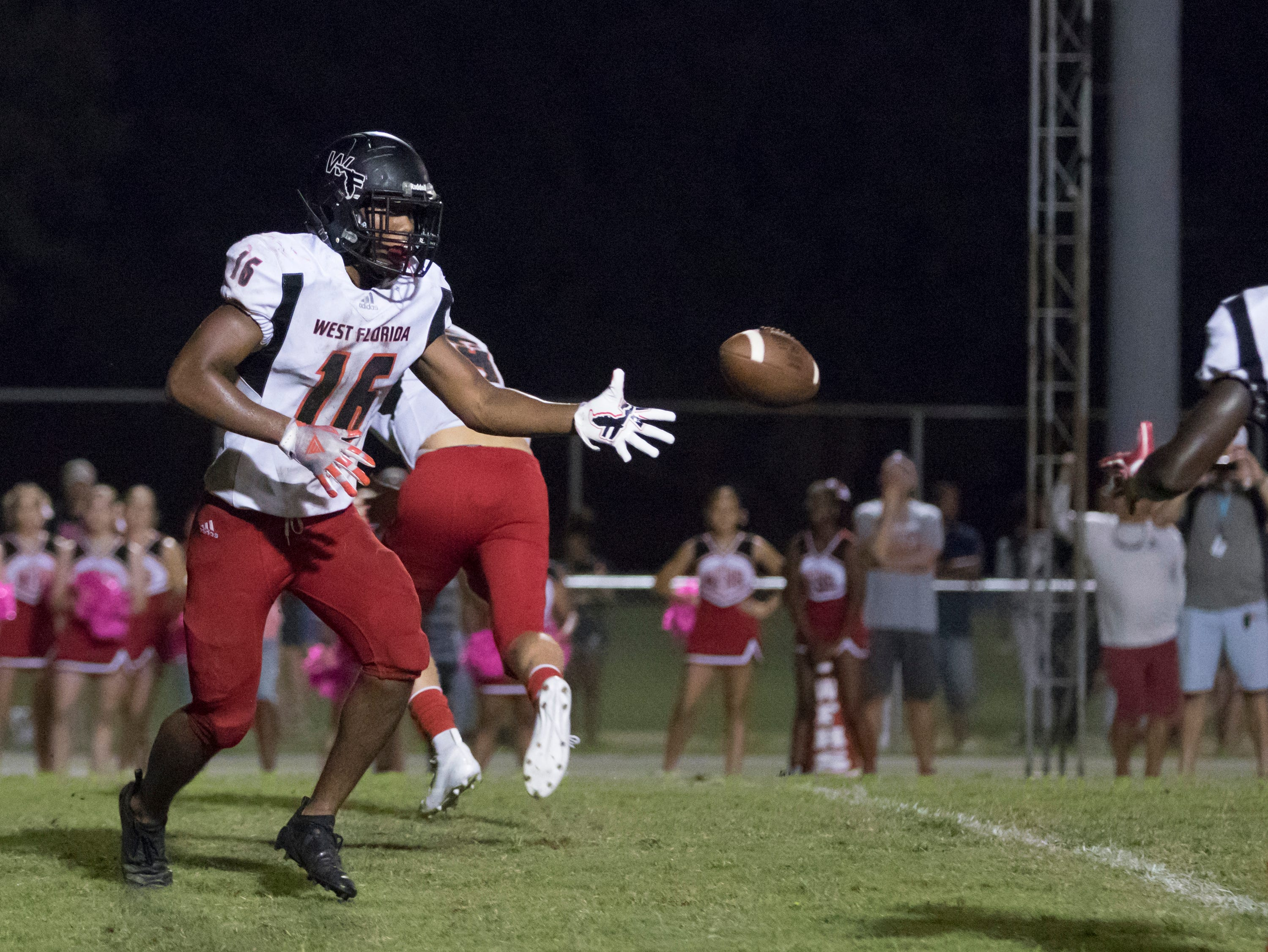 Elijah Edmonds (16) pitches the balll during a failed 2-point converstion attempt during the West Florida vs Pine Forest football game at Pine Forest High School in Pensacola on Friday, October 5, 2018.  The Jaguars' touchdown cut the Eagles lead to 14-12.