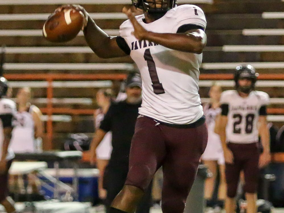 Navarre quarterback Marlon Courtney III (1) throws the ball to wide receiver Dante Wright, not pictured, against the Gators at Escambia High School on Friday, October 5, 2018.