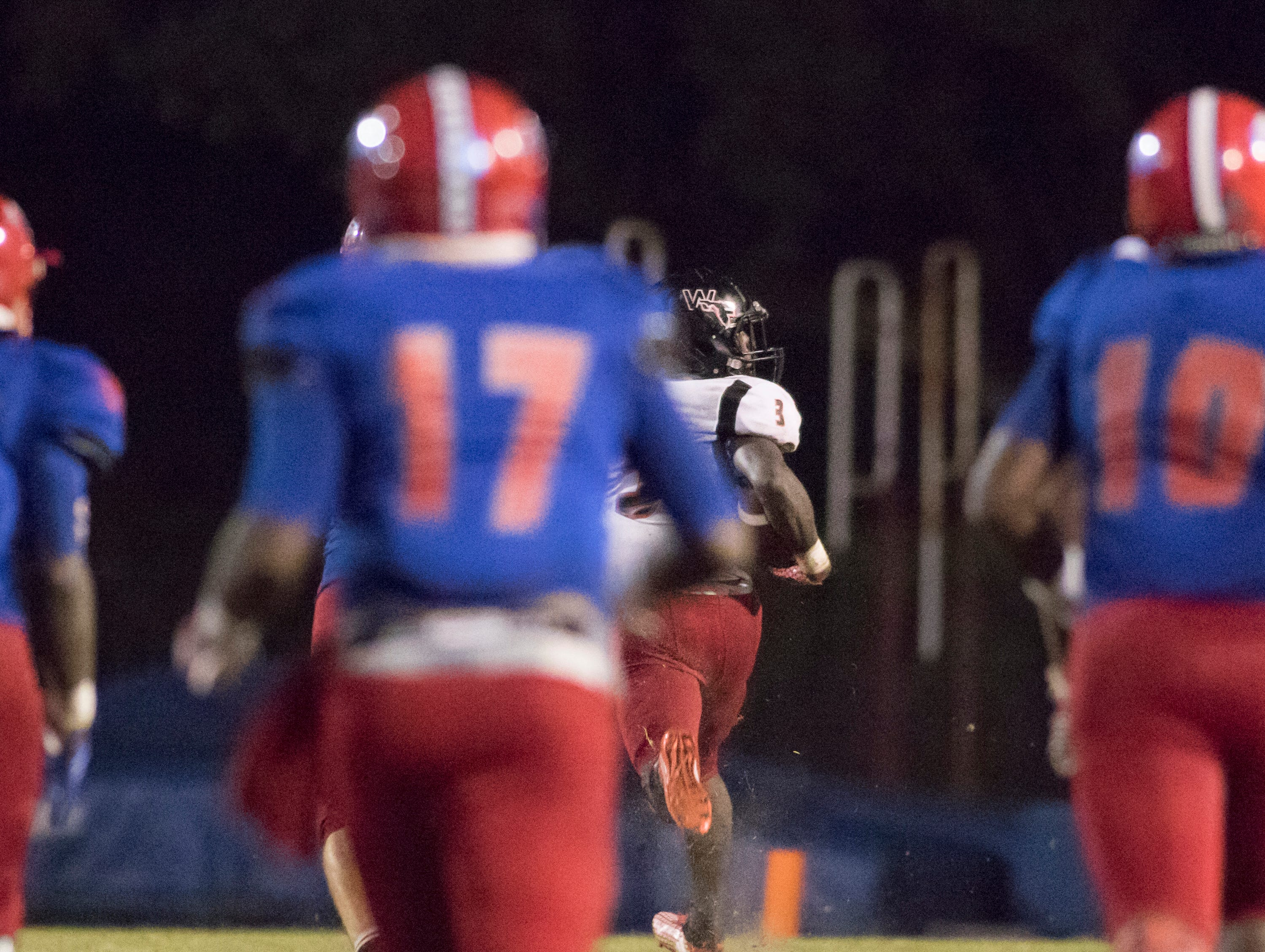Keyshawn Swanson (3) breaks free for a touchdown during the West Florida vs Pine Forest football game at Pine Forest High School in Pensacola on Friday, October 5, 2018.  The Eagles' lead was cut to 24-19 after a successful extra point.