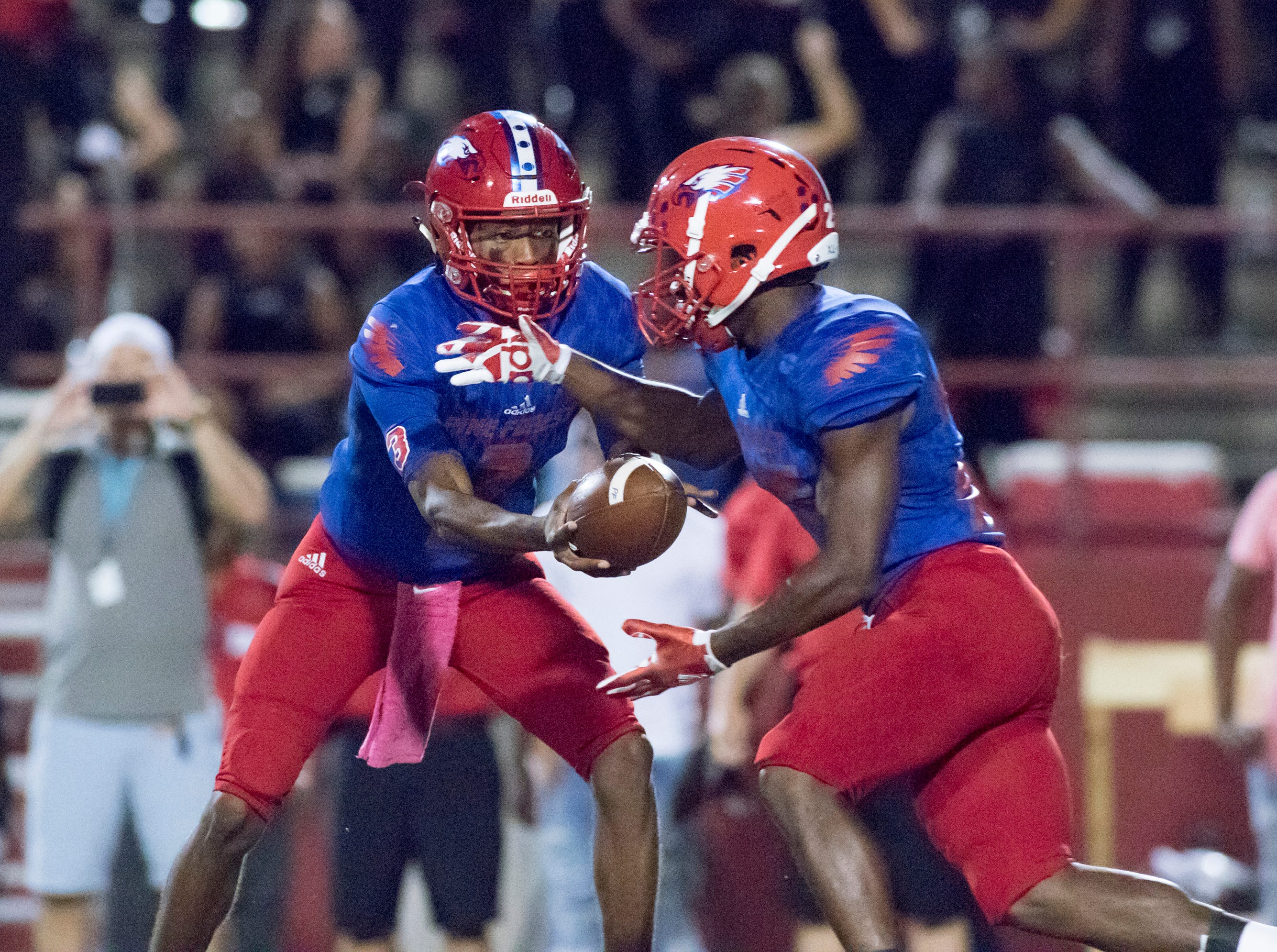 Quarterback Ladarius Clardy (2) hands off to Anwar Lewis (25) during the West Florida vs Pine Forest football game at Pine Forest High School in Pensacola on Friday, October 5, 2018.