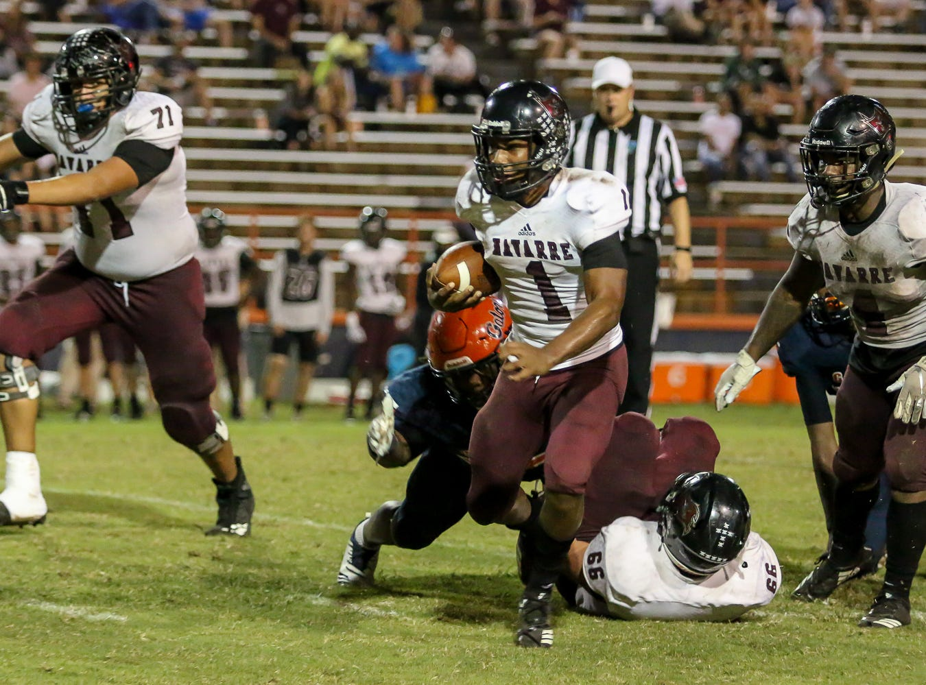 Navarre quarterback Marlon Courtney III (1) keeps the ball and runs against the Gators in the homecoming game at Escambia High School on Friday, October 5, 2018.