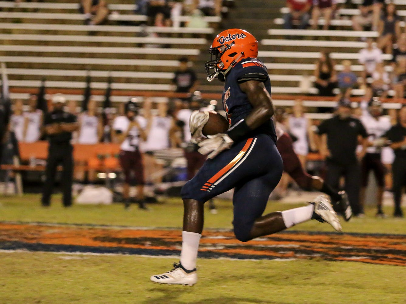Escambia's Frank Peasant (1) races up the field for a touchdown against Navarre in the homecoming game at Escambia High School on Friday, October 5, 2018.