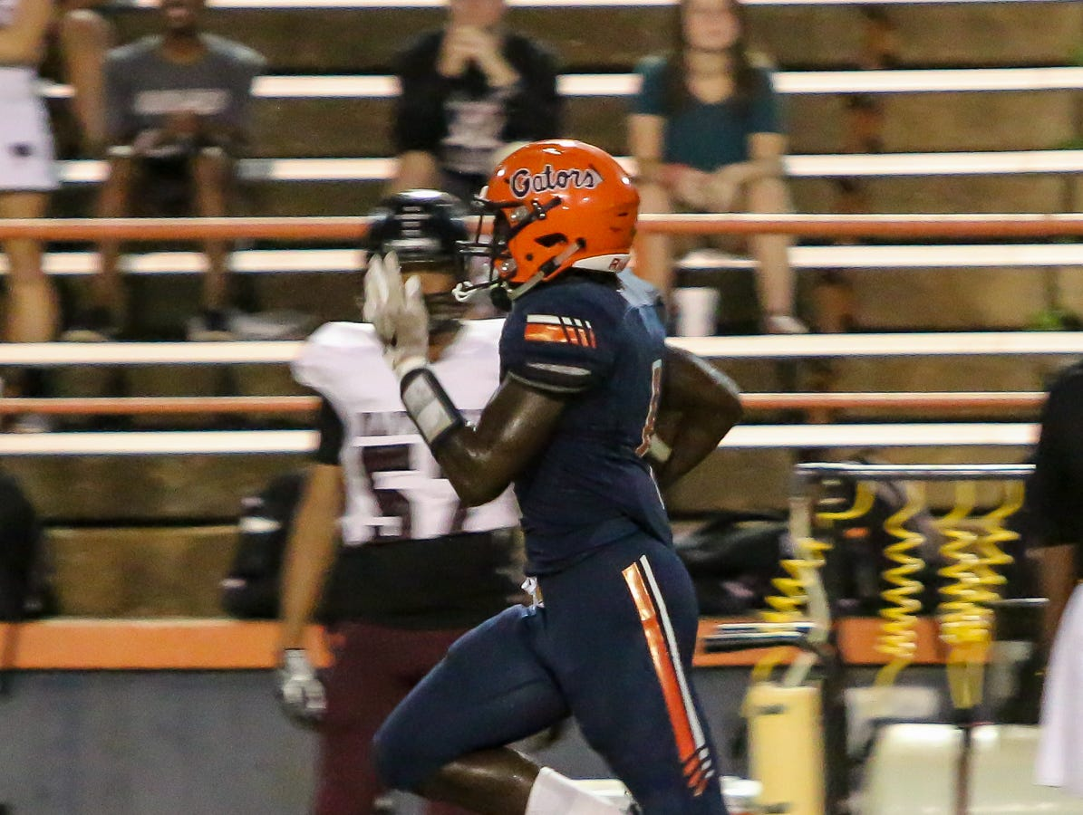 Escambia's Frank Peasant (1) speeds down the sideline for an 83-yard touchdown against Navarre in the homecoming game at Escambia High School on Friday, October 5, 2018.