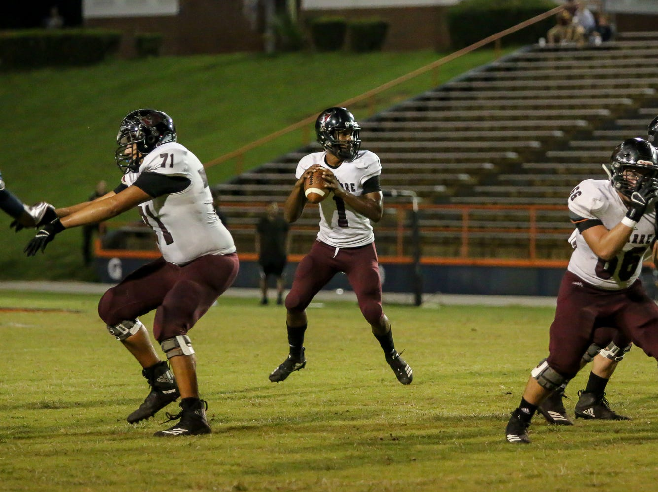 Navarre quarterback Marlon Courtney III (1) stands comfortably in the pocket before throwing a pass against the Gators in the homecoming game at Escambia High School on Friday, October 5, 2018.