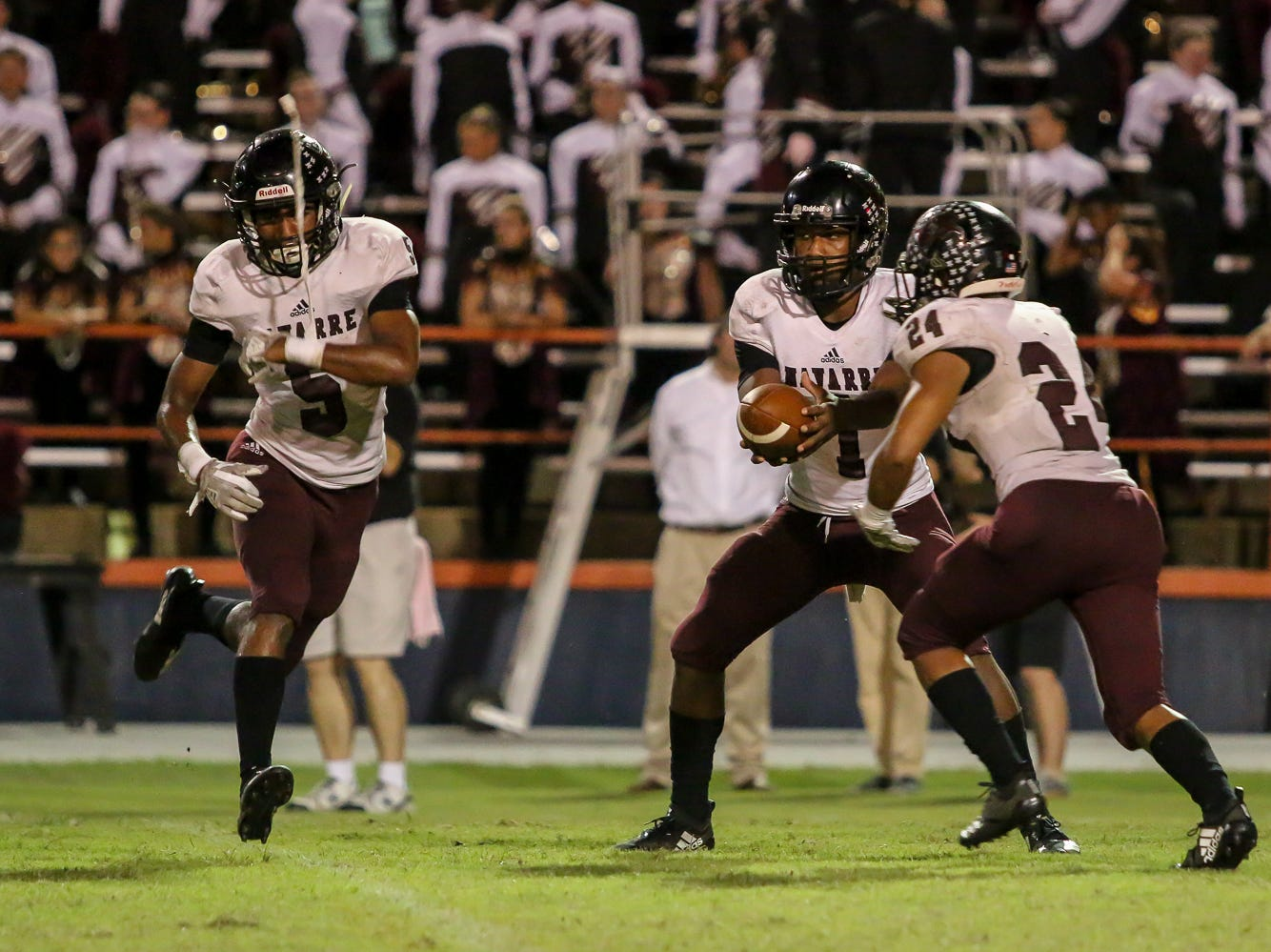 Navarre's Marlon Courtney III (1), Dante Wright (5), and Jaydin Antonio (24) run a fake against the Gators in the homecoming game at Escambia High School on Friday, October 5, 2018.