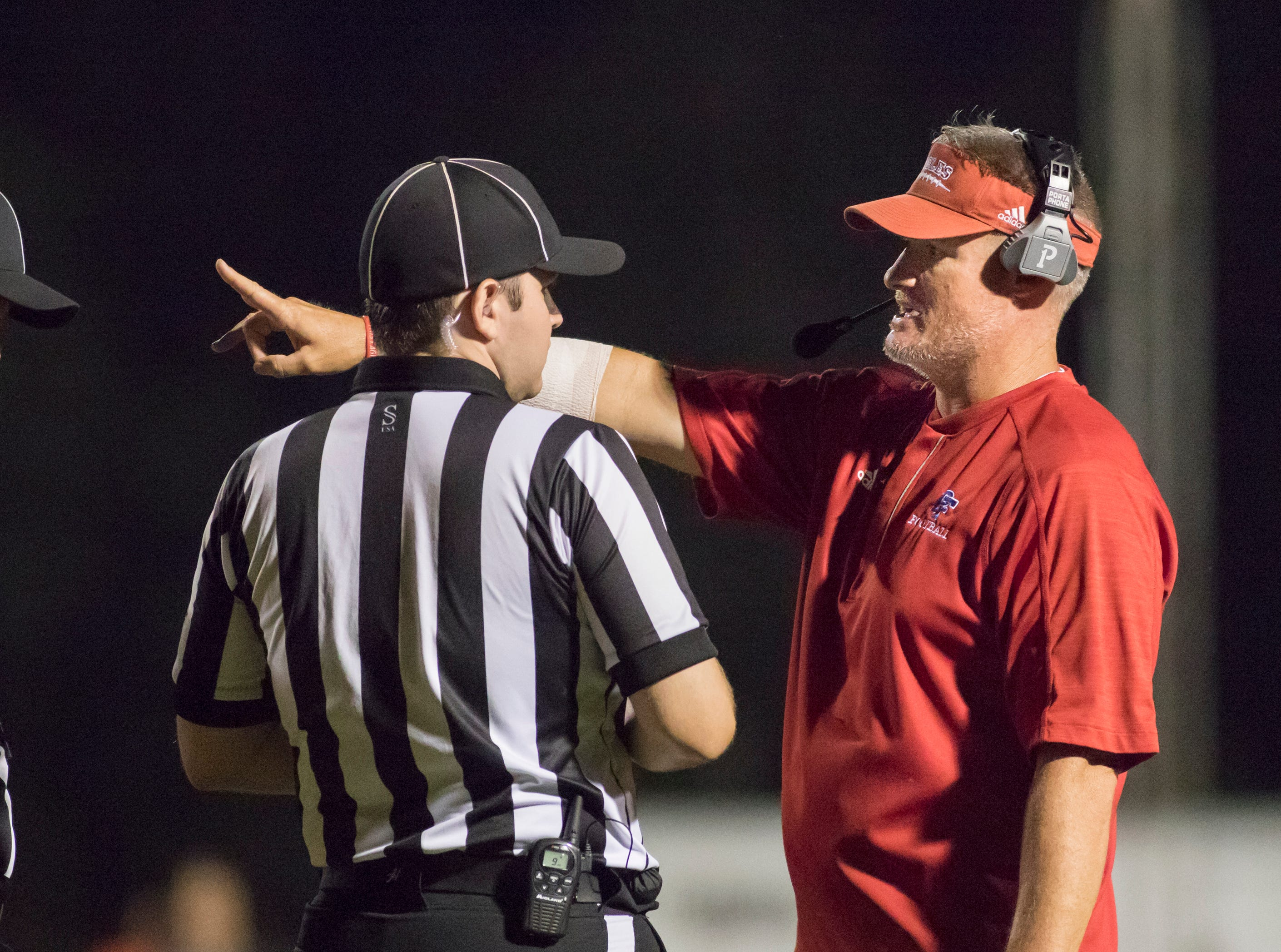 Eagles head coach Jason McDonald talks with the officials during the West Florida vs Pine Forest football game at Pine Forest High School in Pensacola on Friday, October 5, 2018.