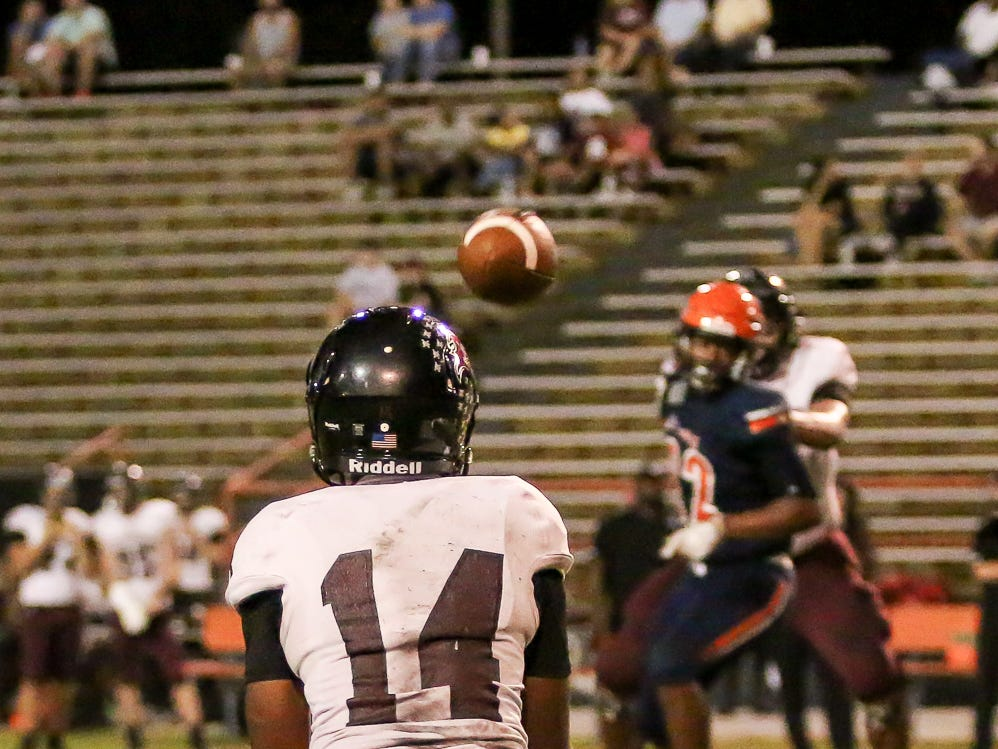 Navarre wide receiver Quinn Caballero (14) catches a pass from quarterback Marlon Courtney III, not pictured,  and heads up the field against the Gators at Escambia High School on Friday, October 5, 2018.