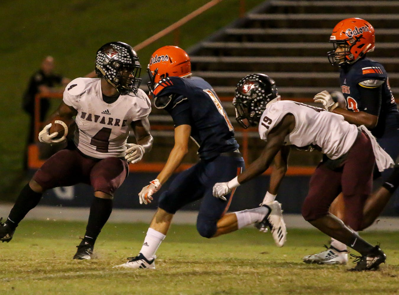 Navarre's Joshua Carter (4) tries to cut back inside for more yards against the Gators in the homecoming game at Escambia High School on Friday, October 5, 2018.