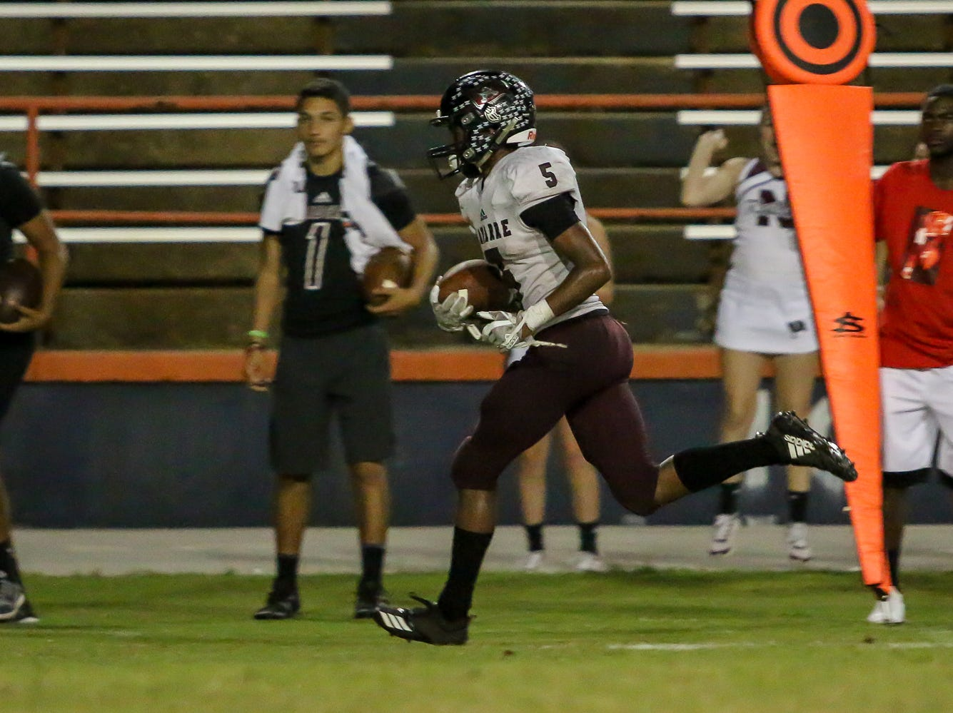 Navarre's Dante Wright (5) heads to the endzone for a 34-yard touchdown catch against the Gators during the homecoming game against Navarre at Escambia High School on Friday, October 5, 2018.