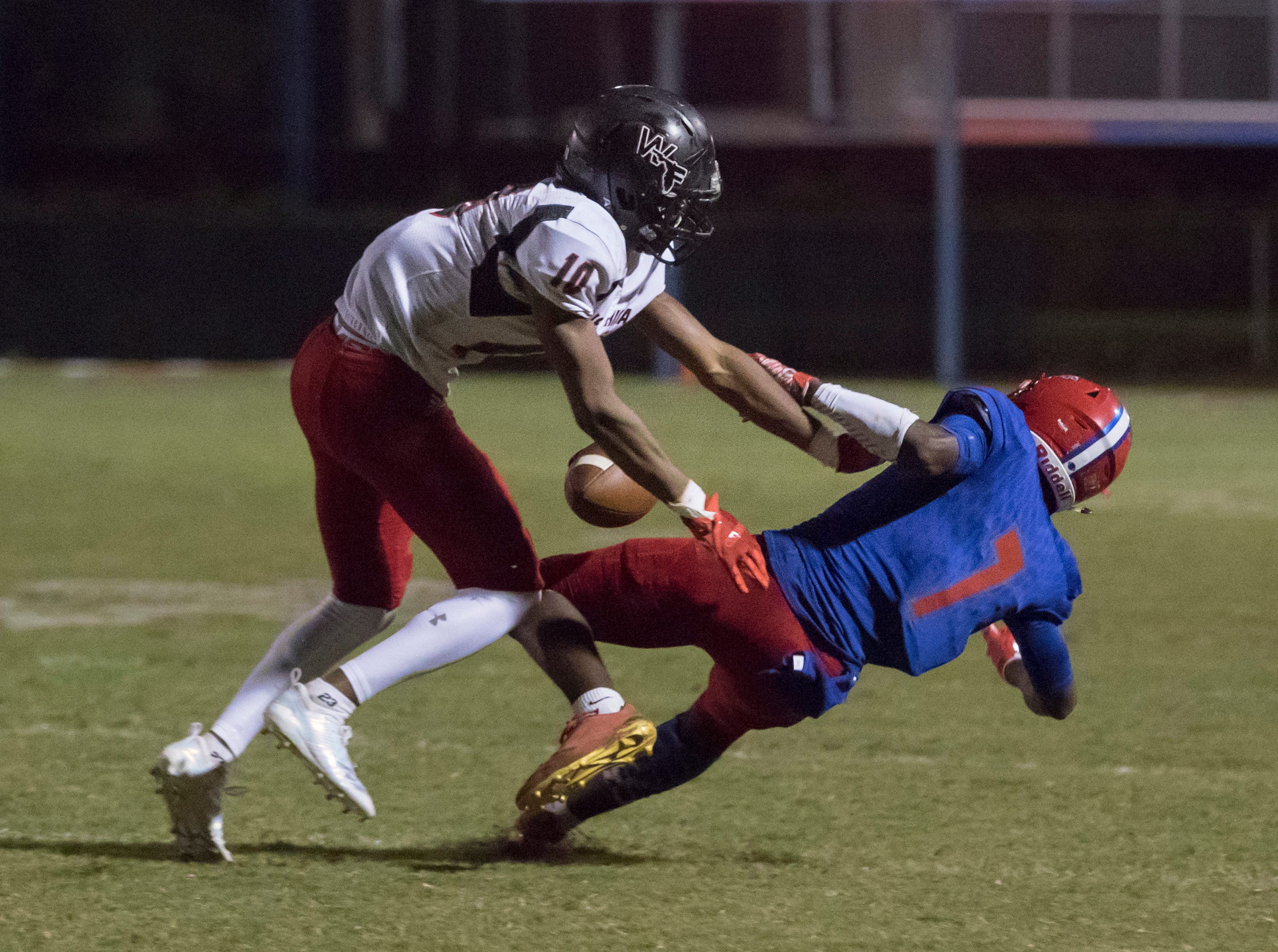 Donte Thompson (10) breaks up the pass to Tehrenzo Turner (7) during the West Florida vs Pine Forest football game at Pine Forest High School in Pensacola on Friday, October 5, 2018.