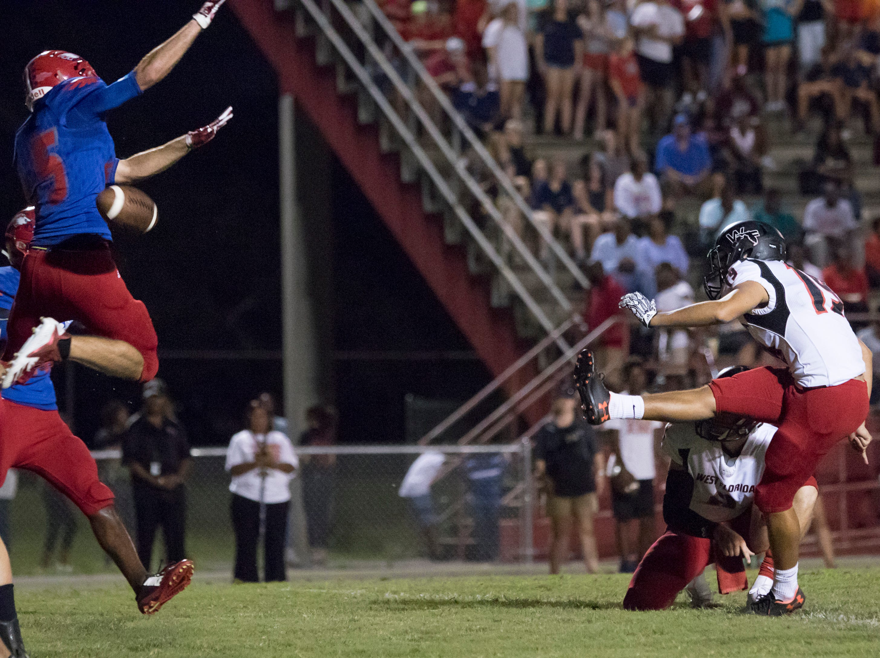 The Jaguars' extra point is blocked during the West Florida vs Pine Forest football game at Pine Forest High School in Pensacola on Friday, October 5, 2018.