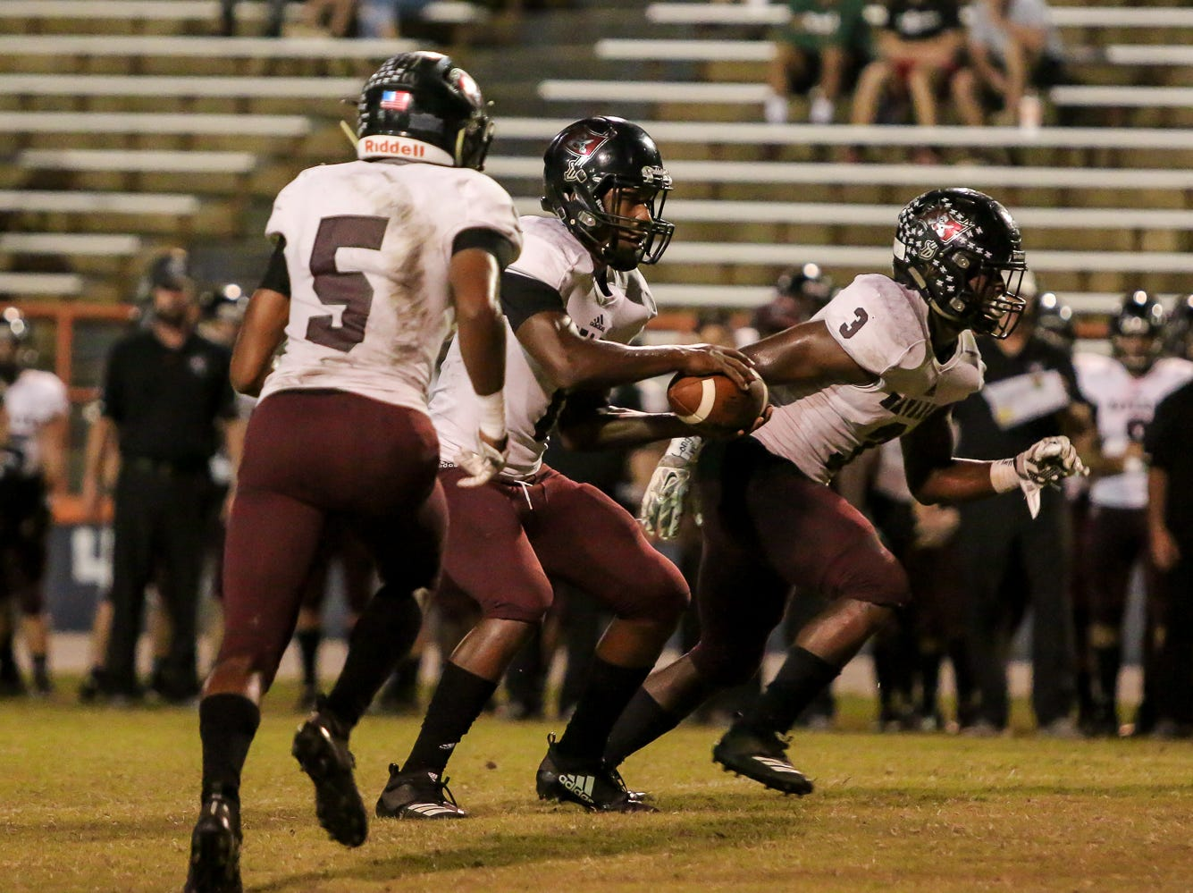 Navarre quarterback Marlon Courtney III (1) prepares to fake a hand off to Dante Wright (5) against the Gators at Escambia High School on Friday, October 5, 2018.