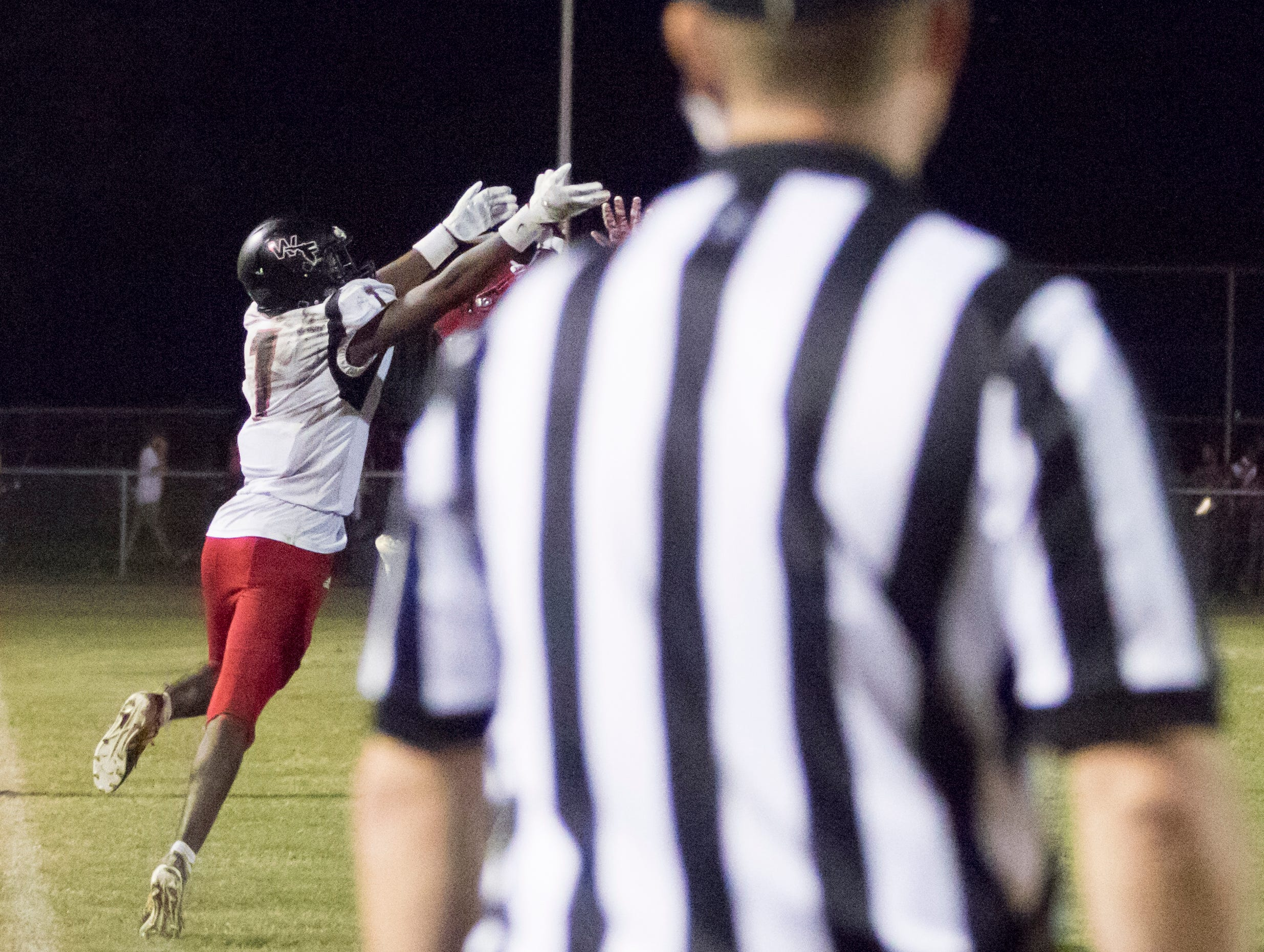 The Eagles intercept a Jaguars pass during the West Florida vs Pine Forest football game at Pine Forest High School in Pensacola on Friday, October 5, 2018.