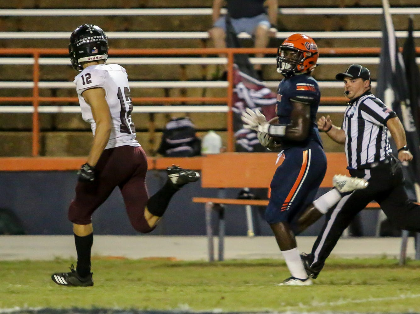 Navarre's Evan Gourley (12) can only watch as Escambia's Frank Peasant (1) speeds down the sideline for an 83-yard touchdown against Navarre in the homecoming game at Escambia High School on Friday, October 5, 2018.