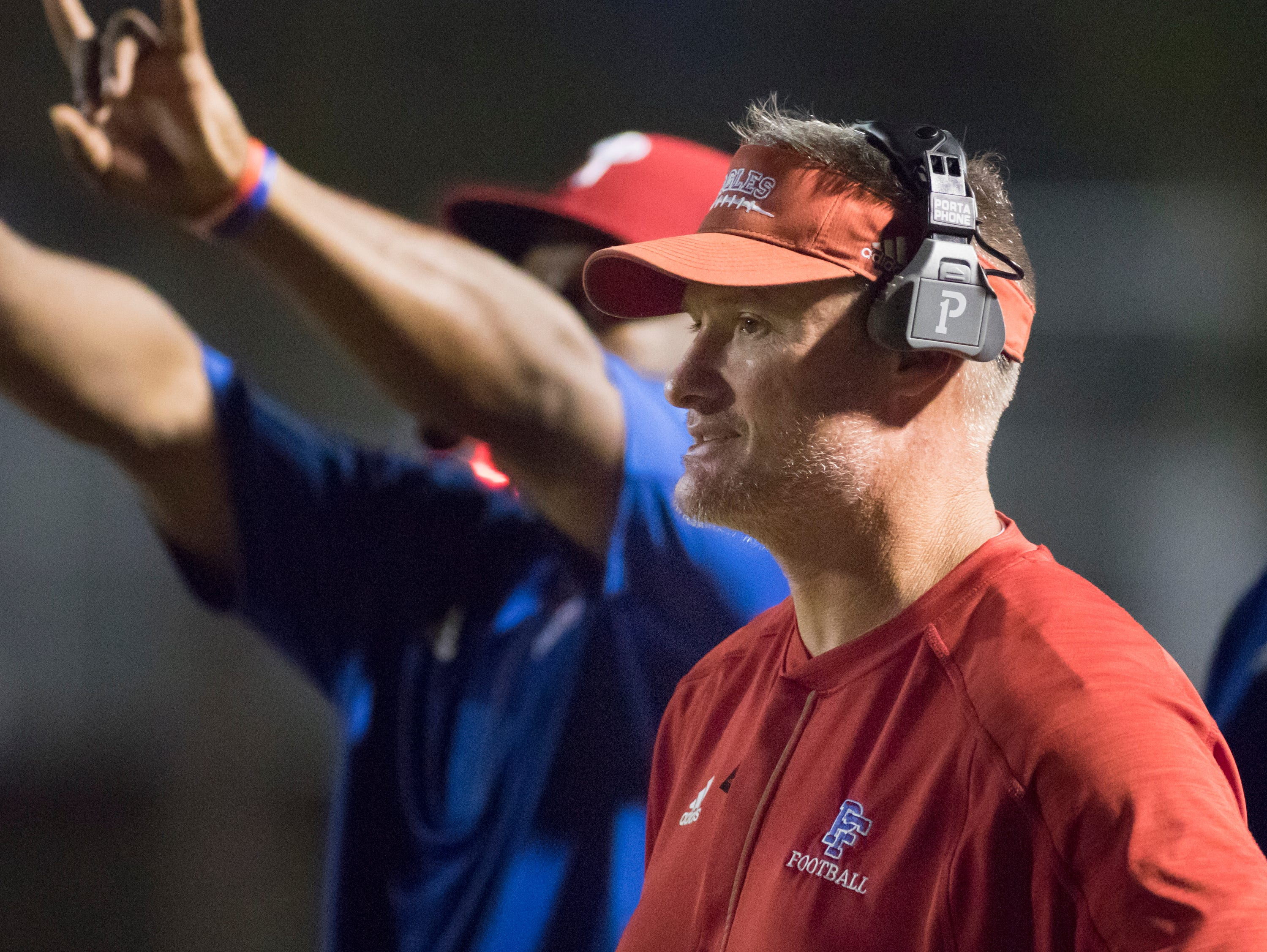 Eagles head coach Jason McDonald keeps an eye on the action during the West Florida vs Pine Forest football game at Pine Forest High School in Pensacola on Friday, October 5, 2018.