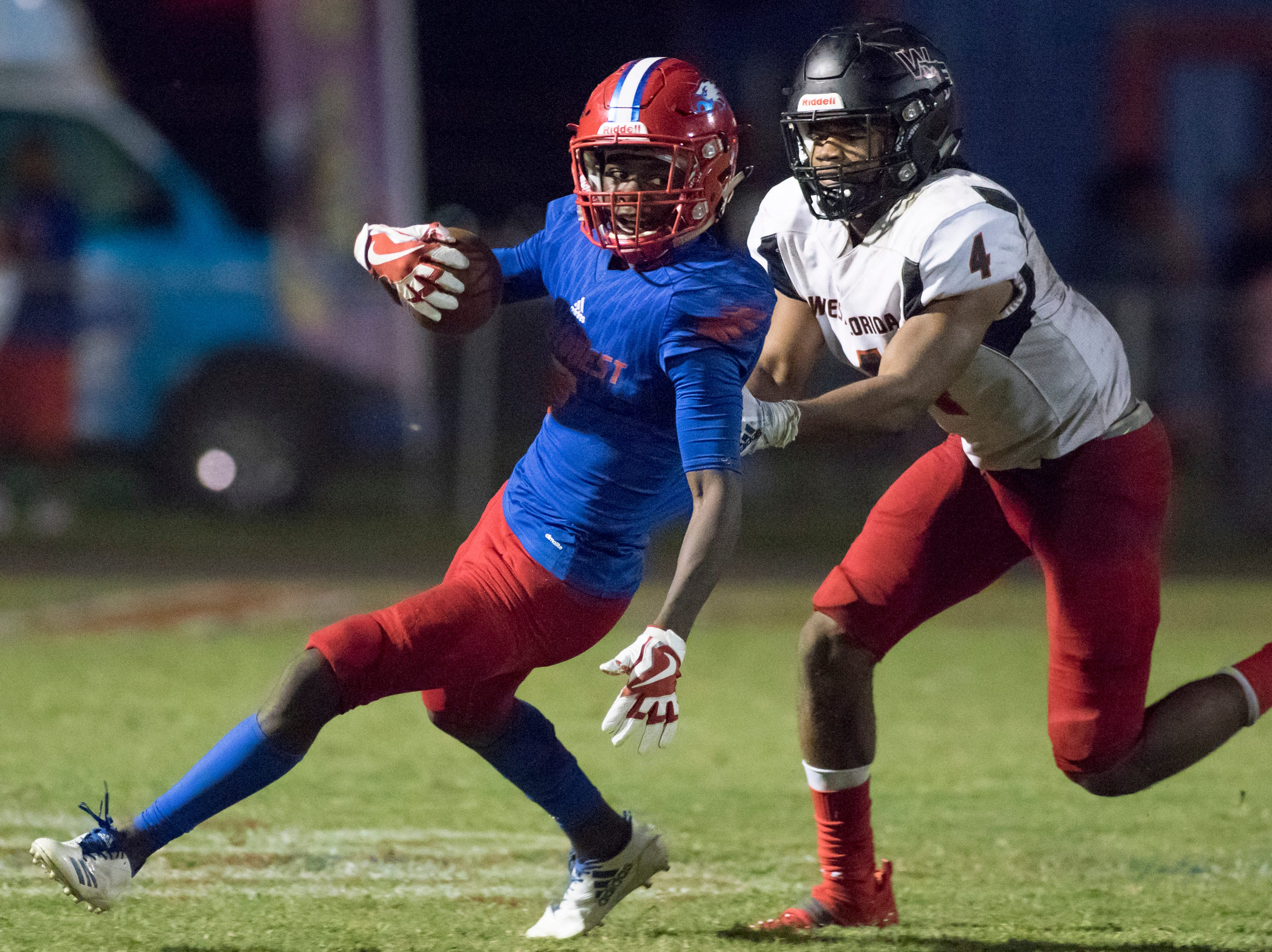 Decarrion McWilliams (5) returns the second half kickoff during the West Florida vs Pine Forest football game at Pine Forest High School in Pensacola on Friday, October 5, 2018.