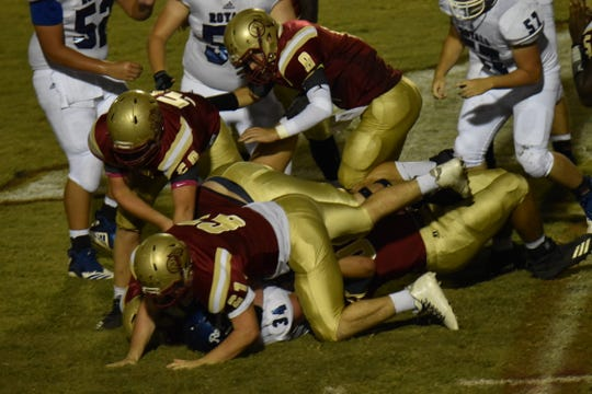 Jay running back James Eddings (34) is smothered for a loss by a swarm of Northview defenders in Friday night's game.